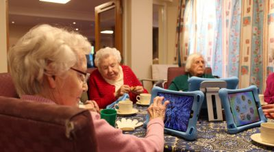 Elderly people using tablet computers