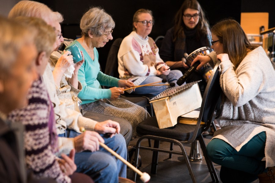 People enjoying learning to play musical instruments
