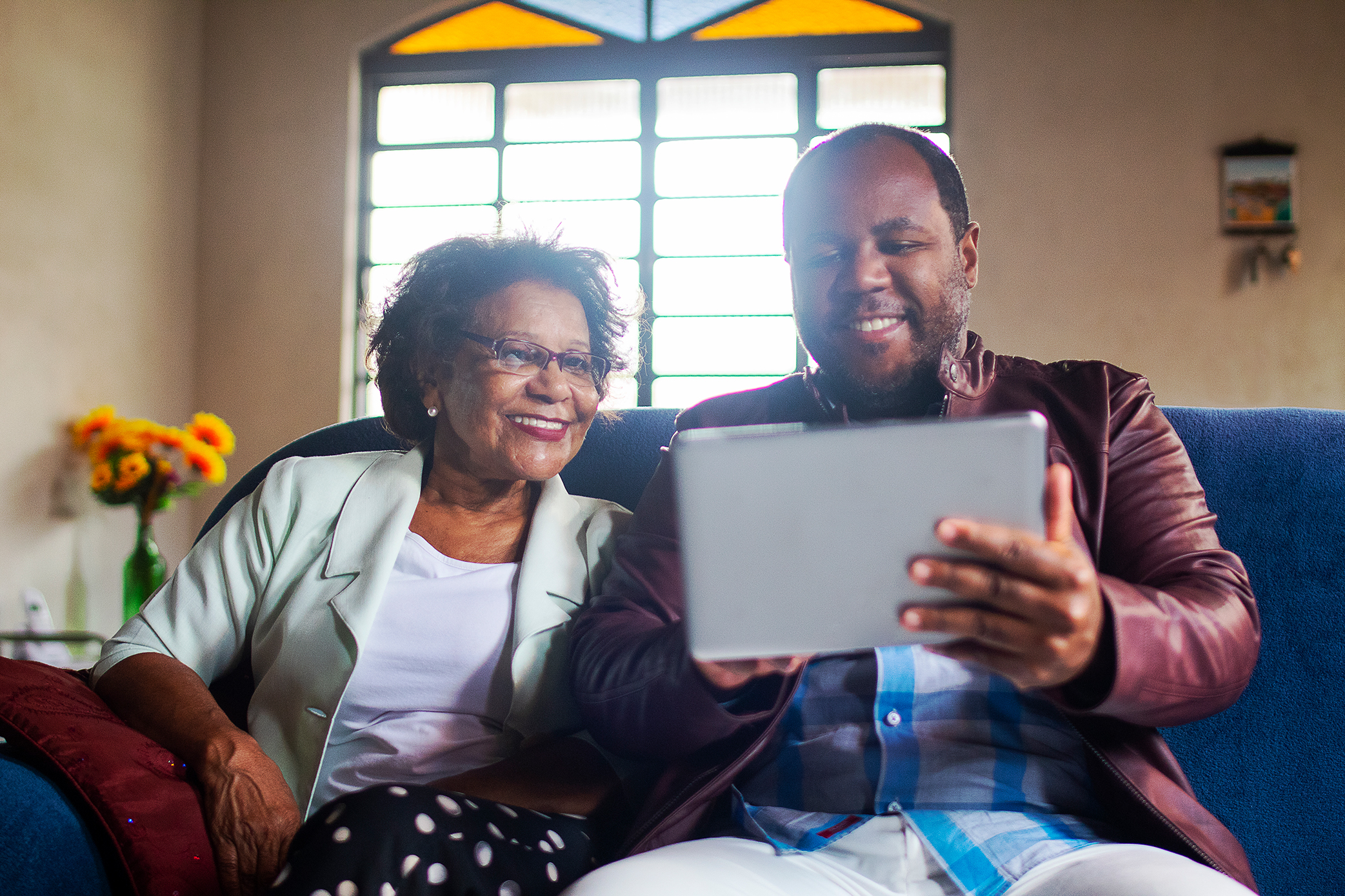 Woman and man looking at a tablet,smiling
