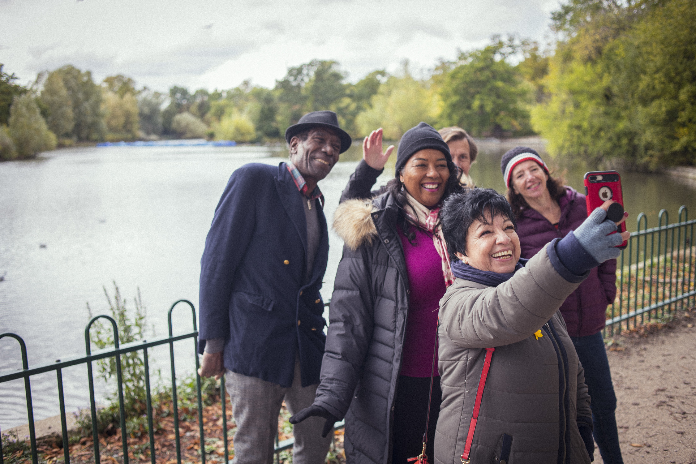 Group taking selfie by lake