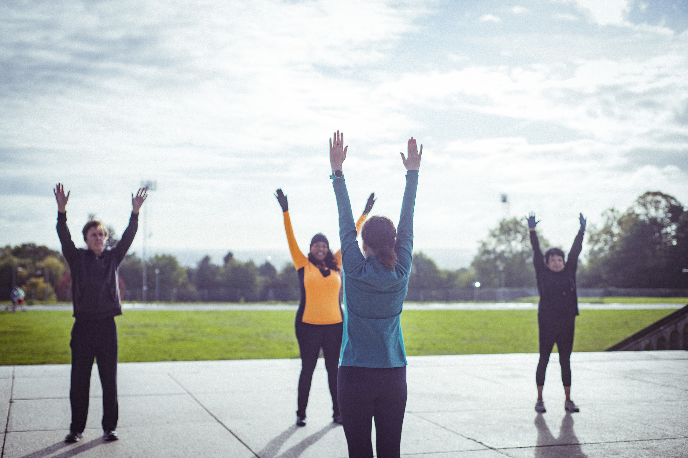 Group exercising in public park